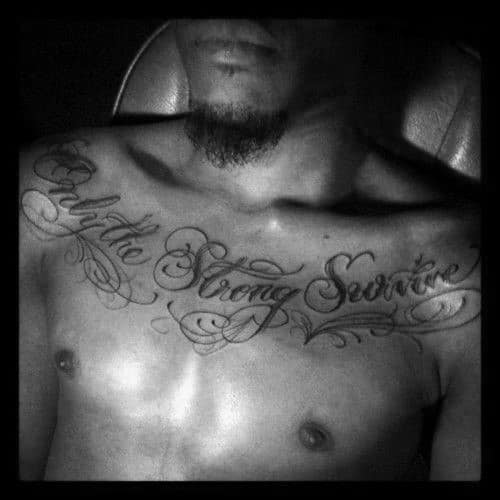 Upper Chest Only The Strong Survive Script Tattoos For Guys