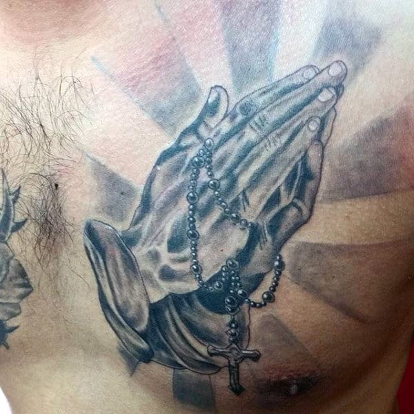 Upper Chest Sun Rays Tattoos Of Praying Hands With Rosary For Guys