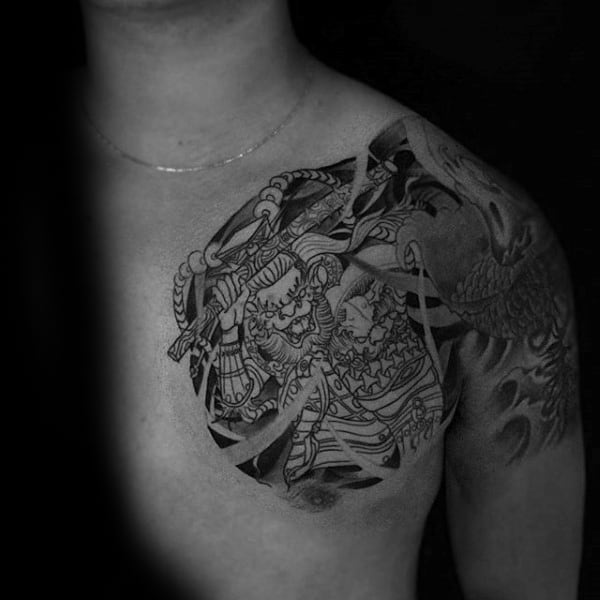 Upper Chest Tattoo Of Monkey King On Man