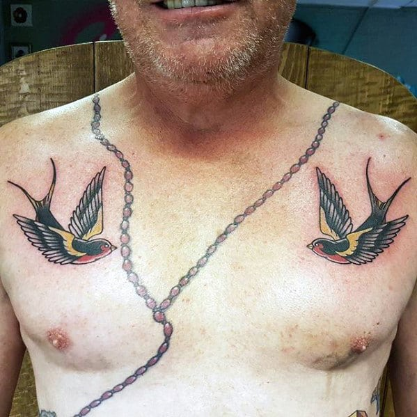Upper Chest Traditional Guys Swallow Tattoo Deisgns