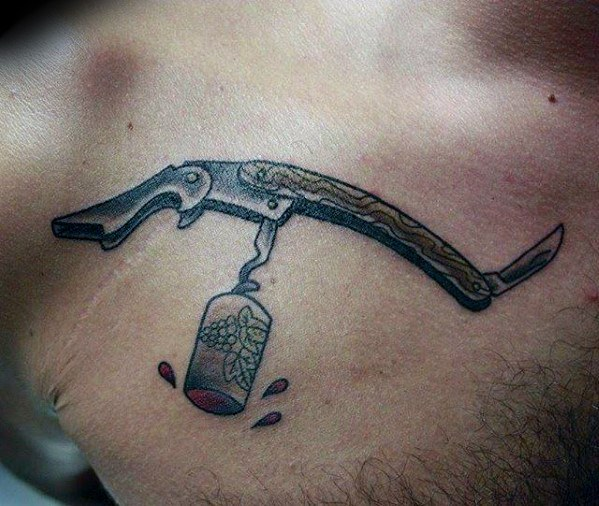 Upper Chest Wine Opener Mens Tattoo Ideas