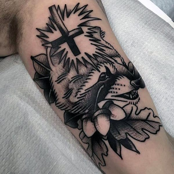 Upside Down Cross With Raccoon Guys Arm Tattoos