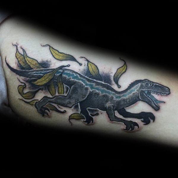 Velociraptor Moving Through Leaves Guys Inner Arm Bicep Tattoo