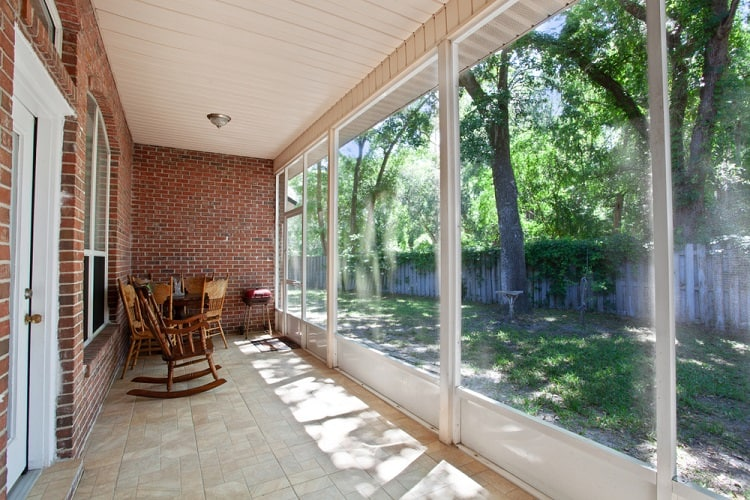 Veranda Screened In Porch With Chairs