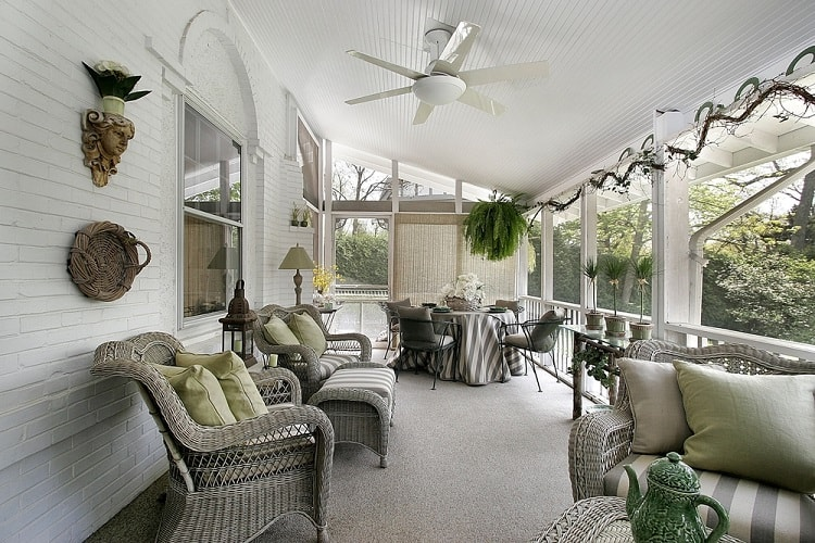 Veranda Screened In Porch With Wicker Furniture