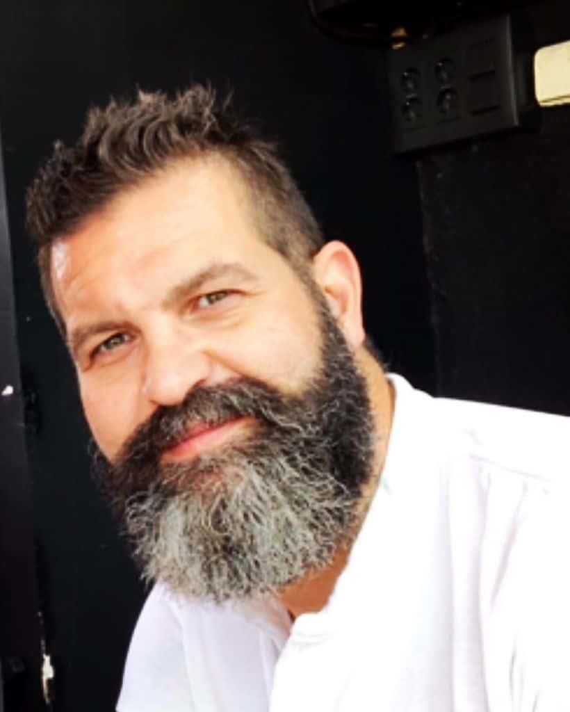 A man with a well-groomed full beard