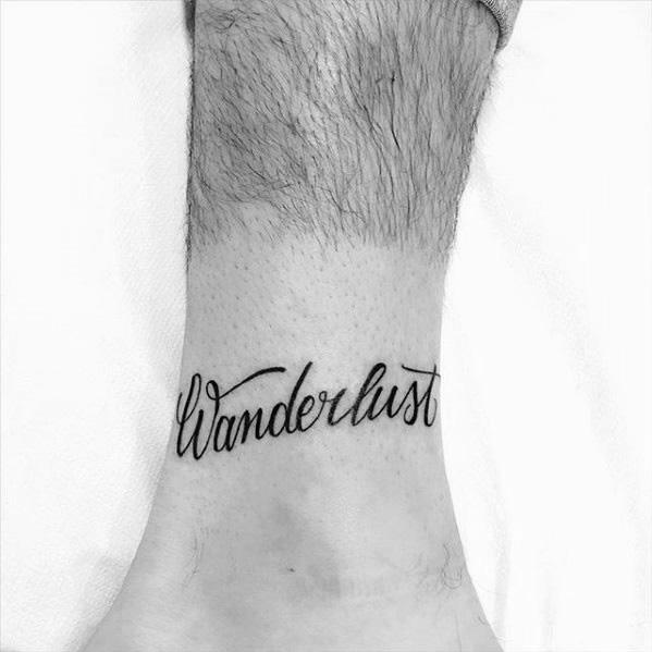 Wanderlust Script Guys Lower Leg Word Tattoo