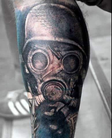 War Helmet And Gas Mask Guys Tattoo On Leg Calf