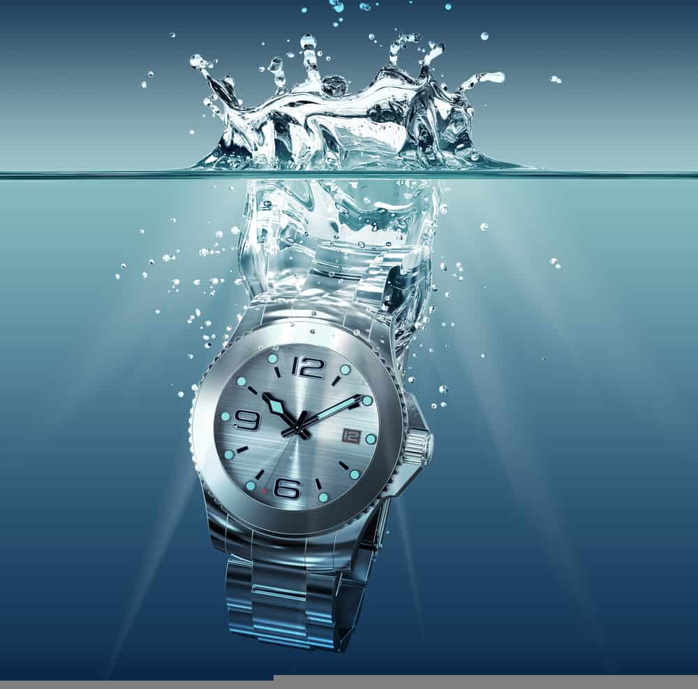 3d illustration of wrist watch falling into water