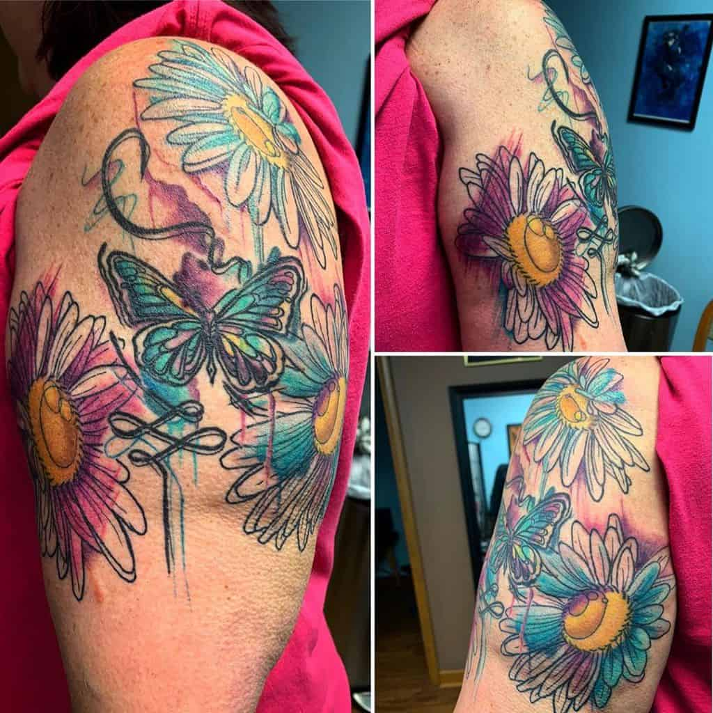 Upper arm tattoo water color daisy and butterfly
