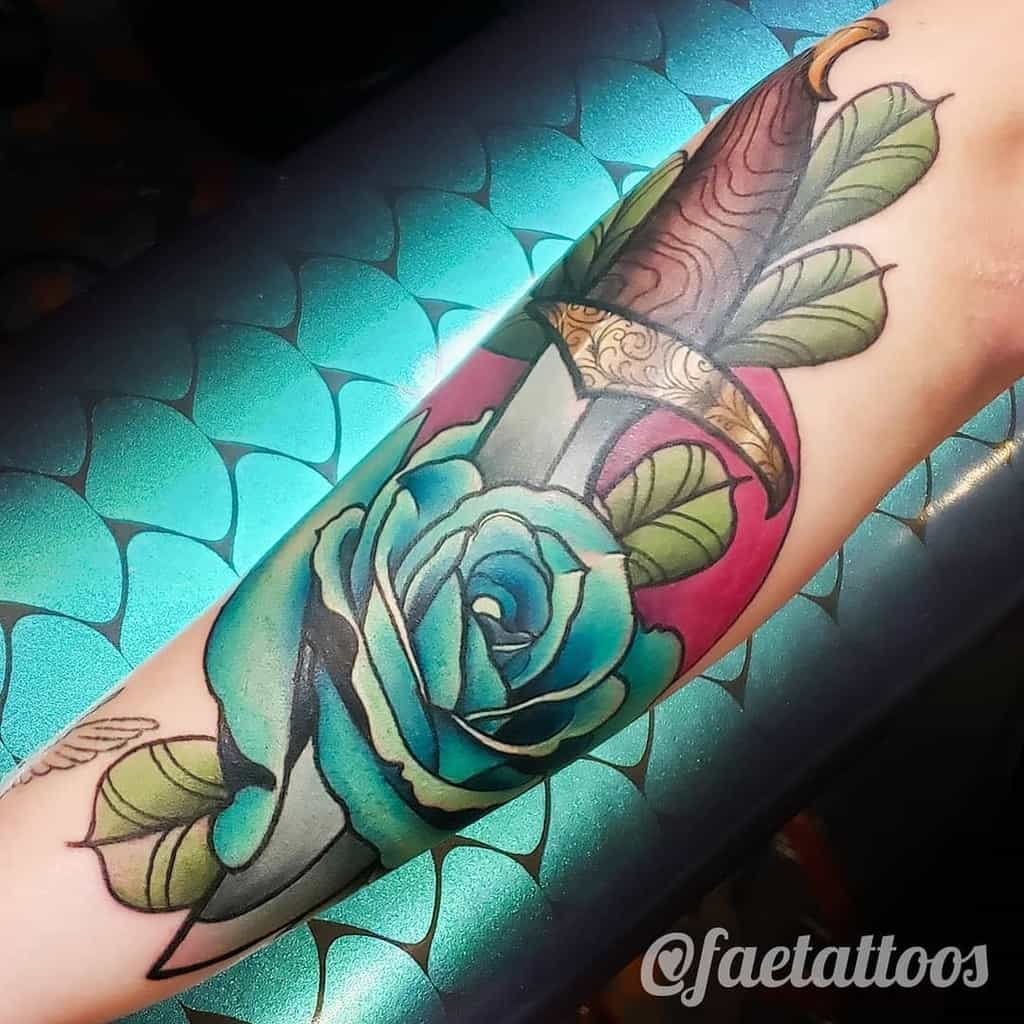 watercolor colored rose and dagger tattoos faetattoos
