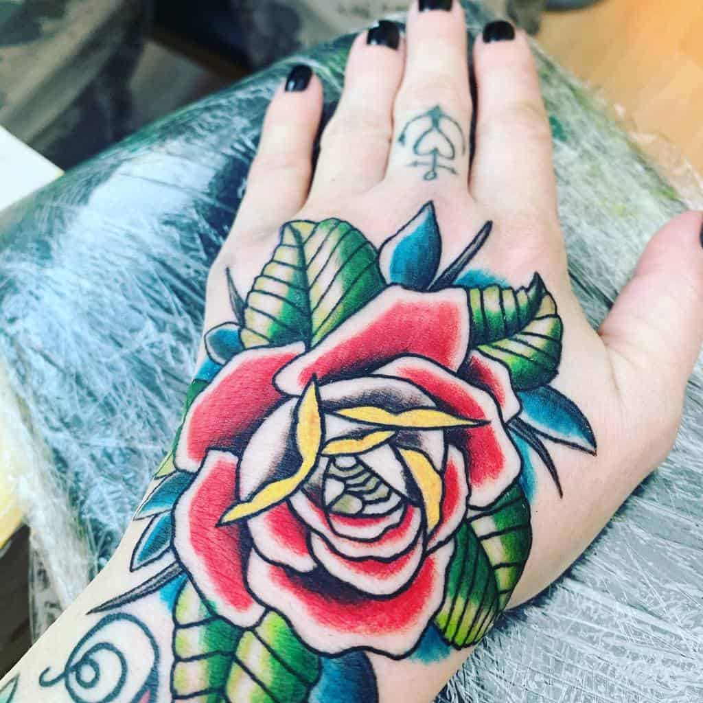 watercolor colored rose hand tattoos nance_davey