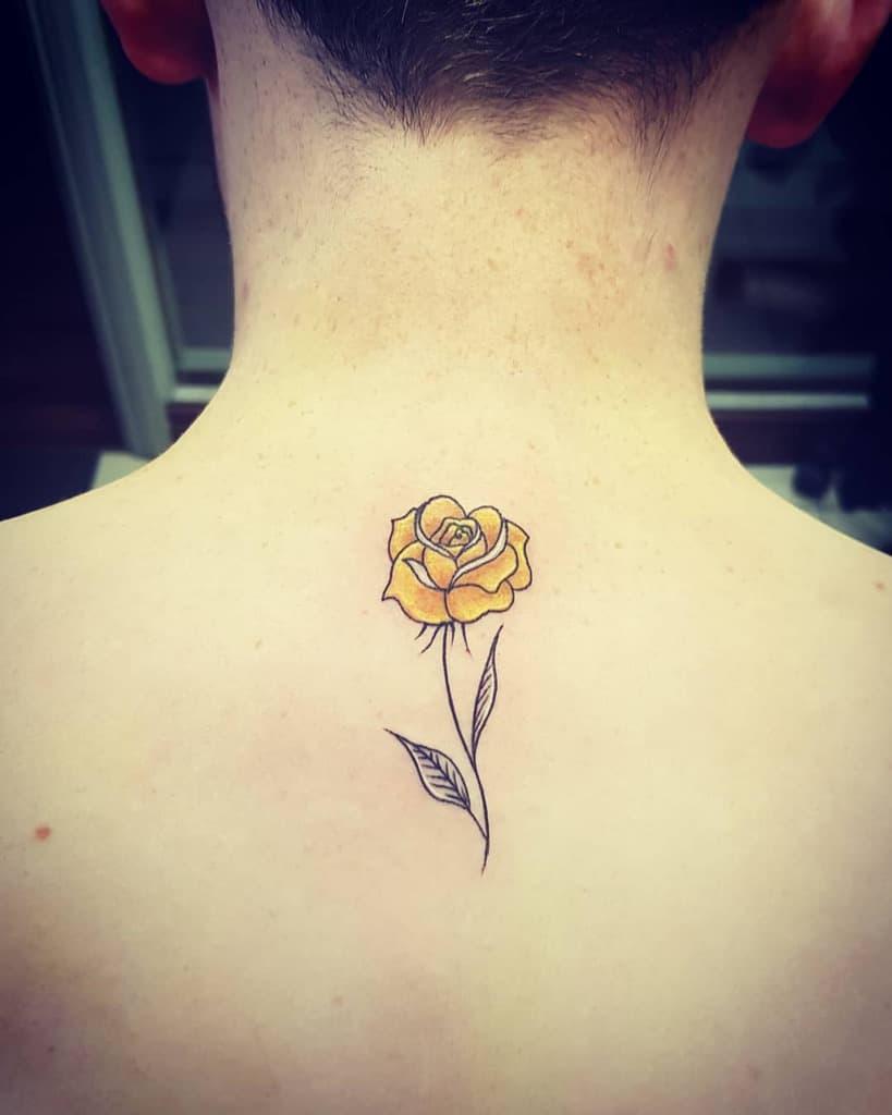 watercolor colored simple rose tattoos blondiekeogh