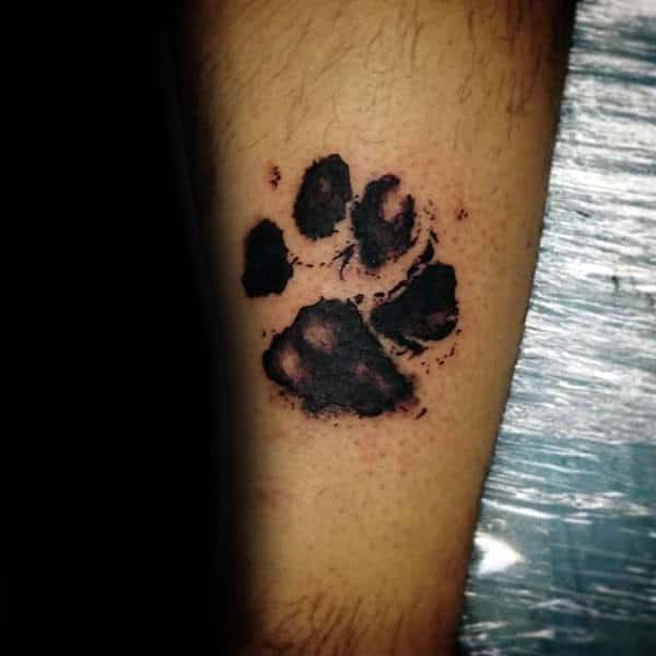 Watercolor Footprint Black Ink Tattoo On Males Arm
