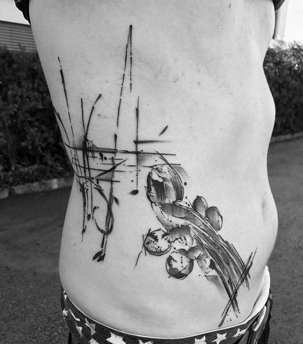 Watercolor Rib Cage Side Male Music Staff Tattoo Design Inspiration