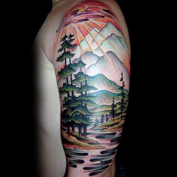 Watercolor Scene Of Sunrays Through Forest Upper Sleeve Tattoo On Man
