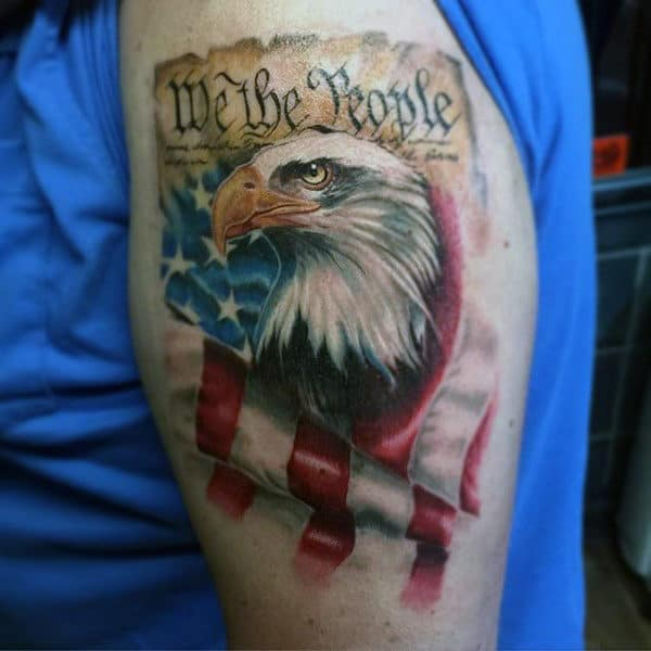 Waving American Flag We The People Upper Arm Tattoo For Men