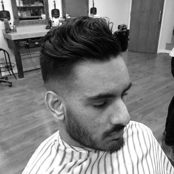 Wavy Medium Length Quiff Mens Skin Fade Haircut