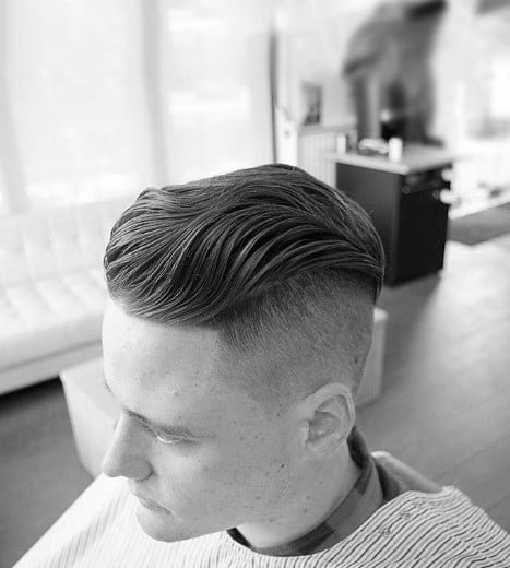 Wavy Slicked Back Undercut Hair For Guys