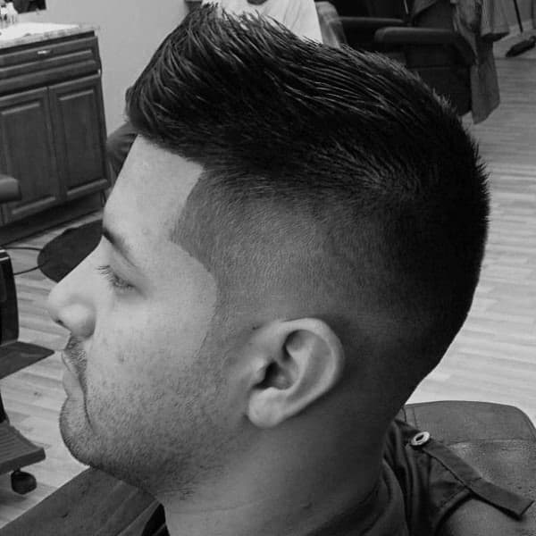 Well Groomed Mens Faux Hawk Fade Hairstyle Taper