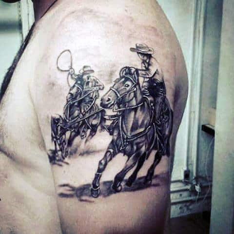 Western Men Chasing On Horse With Lasso Tattoo In Black And Grey