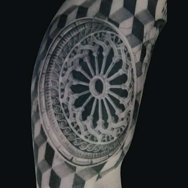 Wheel Circular Optical Illusion Tattoo On Bicep