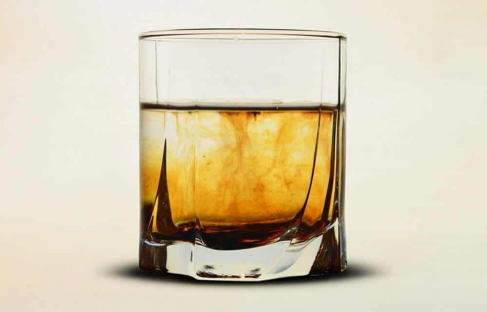 half filled whiskey glass focus