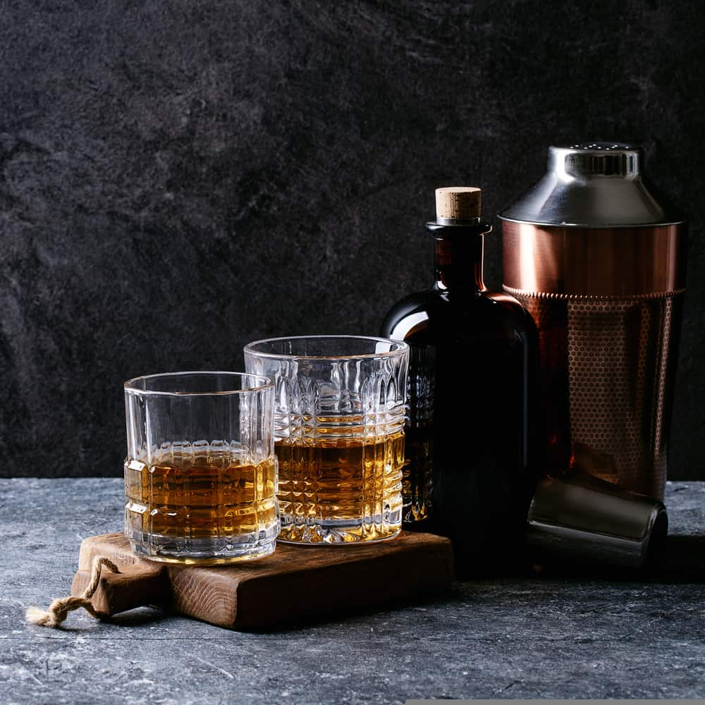 whiskey with copper shaker, whiskey bottle and glasses