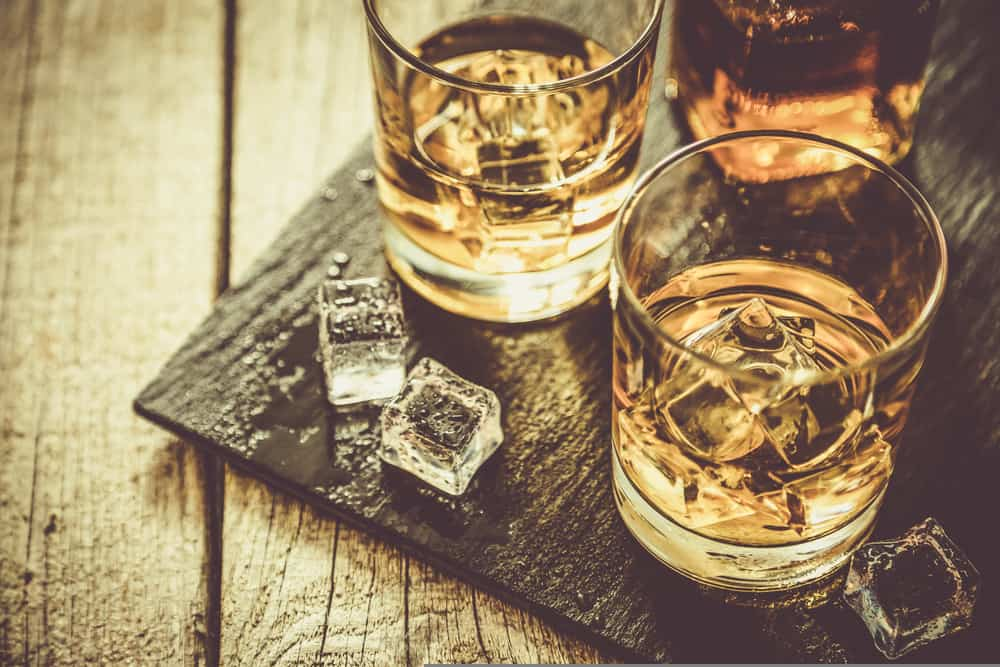 whiskey in drinking glasses with ice