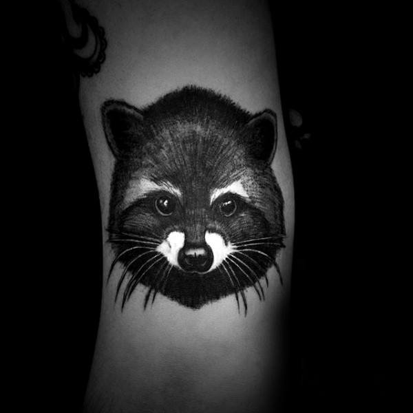 White And Black Ink Male Small Raccoon Head Tattoo On Forearm