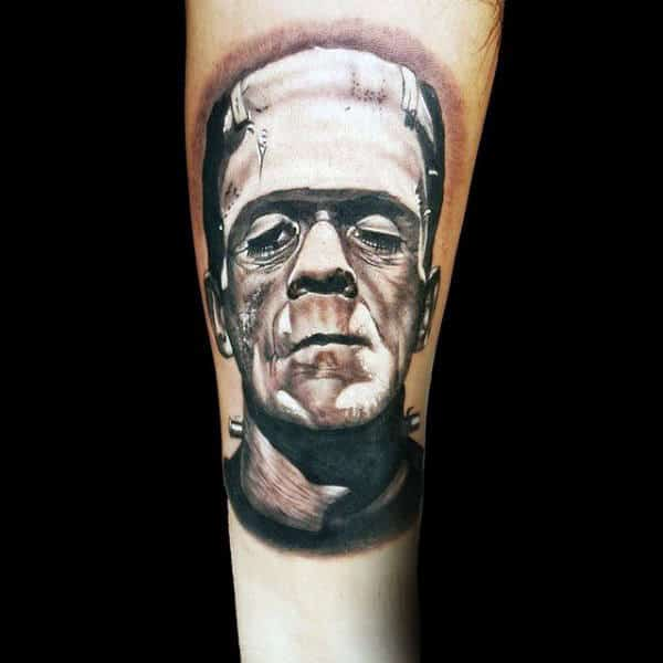 White And Black Ink Shaded Frankenstein Tattoo On Man