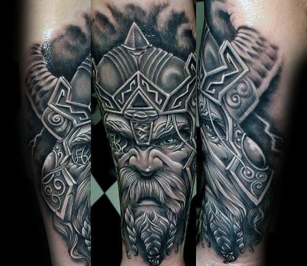 White And Grey Shaded Male Odin Head Tattoo On Forearm
