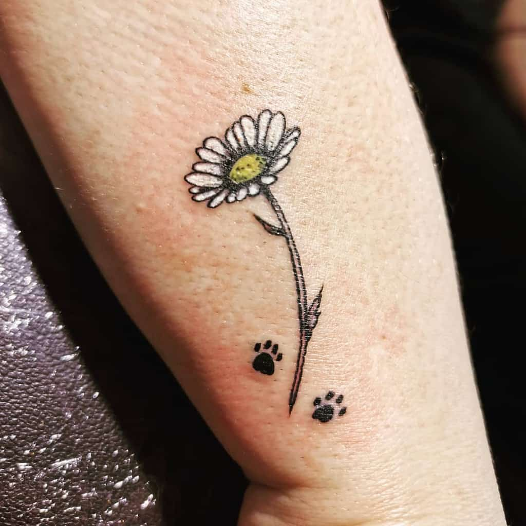 Wrist tattoo small simple color paw prints white and yellow daisy