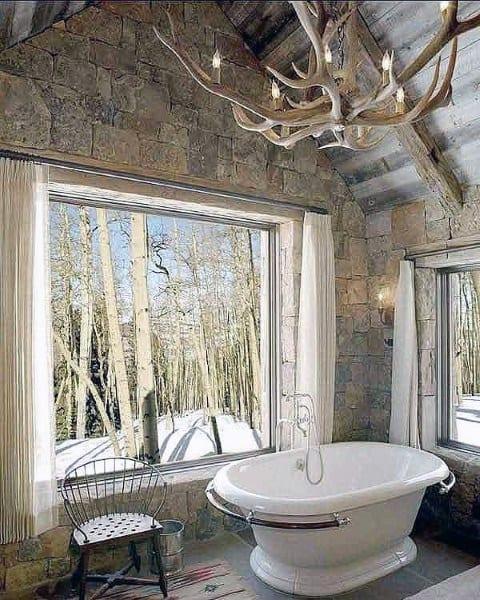 White Bathtub With Stone Wall Covering Rustic Bathroom Ideas
