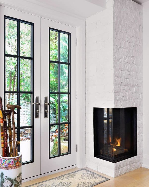 White Brick Stone Corner Fireplace Design Ideas