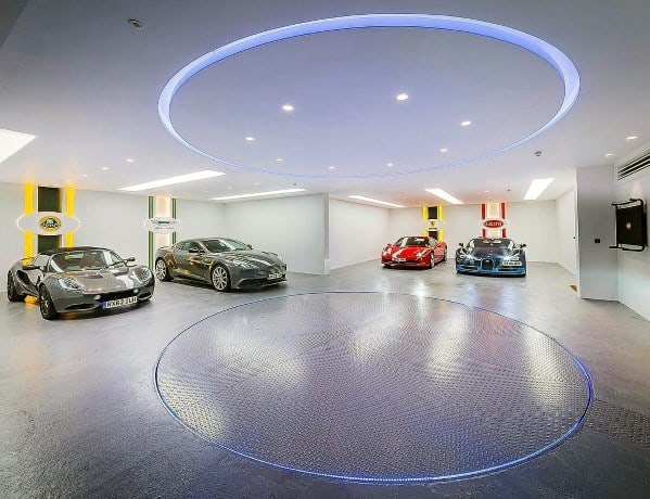 White Drywall With Painted Car Logos Finished Garage Wall Ideas