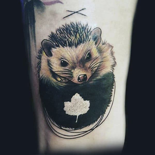 White Ink Leaf Tattoo On Man With Hedgehog In Color