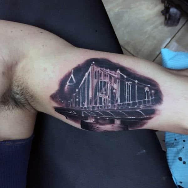 White Ink Over Black Bridge Mens Bicep Tattoos
