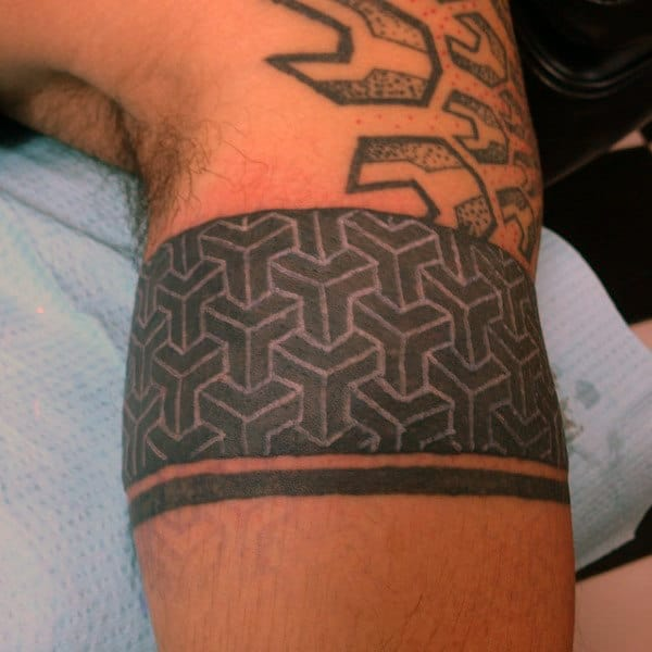 White Ink Over Black Mens Bicep Tattoo Of Pattern Shapes