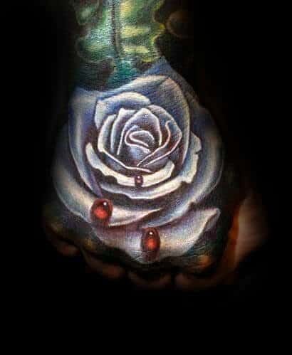 White Ink Realistic Rose Hand Tattoo With Red Water Droplets For Males