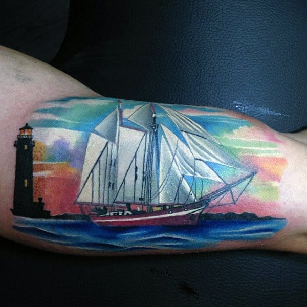 White Ink Sailboat With Skys Artistic Bicep Tattoos For Men