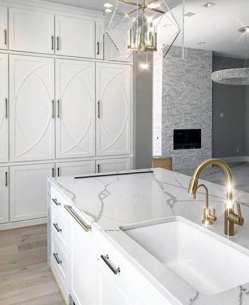 White Kitchen Cabinets With Gold Facuet And Gold Hardware Pull Handles