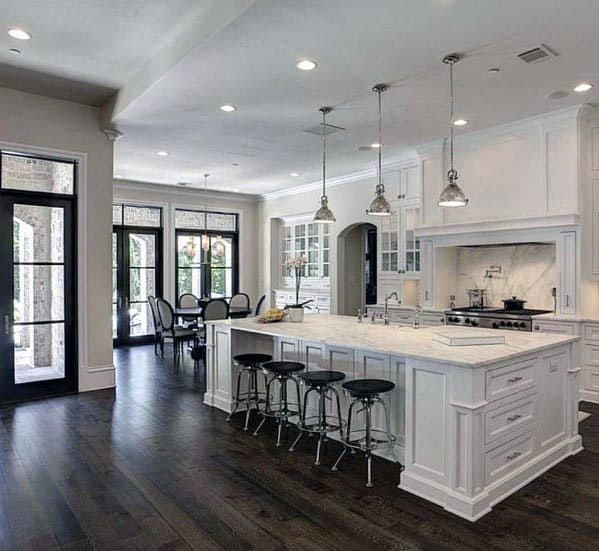 White Kitchen With Dark Hardwood Flooring