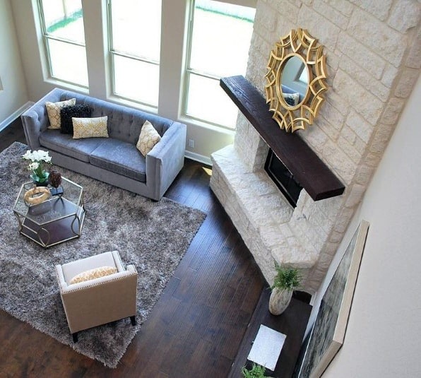 White Stone Wall Corner Fireplace Design In Living Room