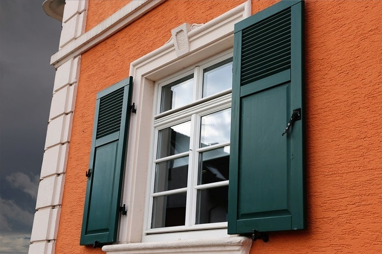 White Stucco Exterior Window Trim With Black Shutters