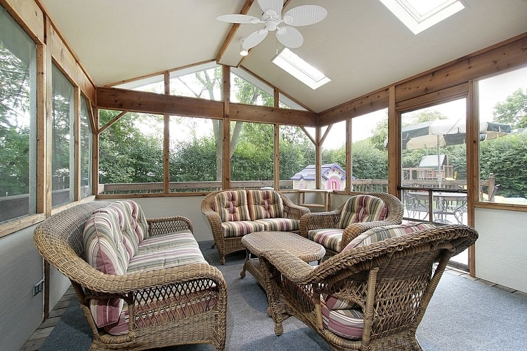 Wicker Furniture In Screened In Sun Porch