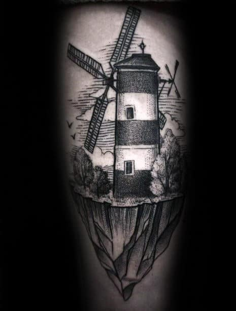 Windmill On A Mountain Cliff Mens Leg Tattoo