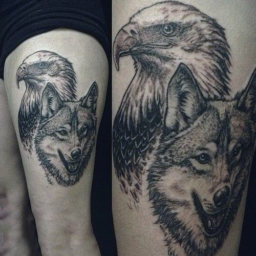 Wold And Eagle Guys Upper Thigh Tattoos