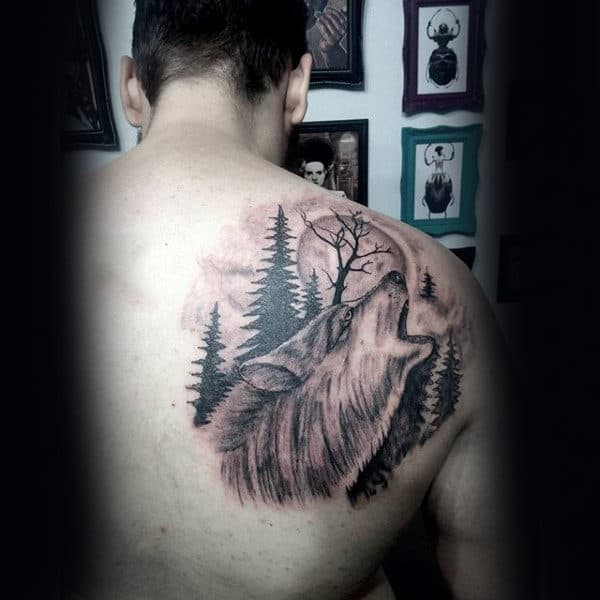 Wolf Howling At Moon With Pine Tree Mens Upper Back Tattoo