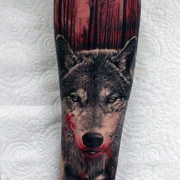 wolf-with-blood-red-forest-mens-realistic-forearm-sleeve-tattoo